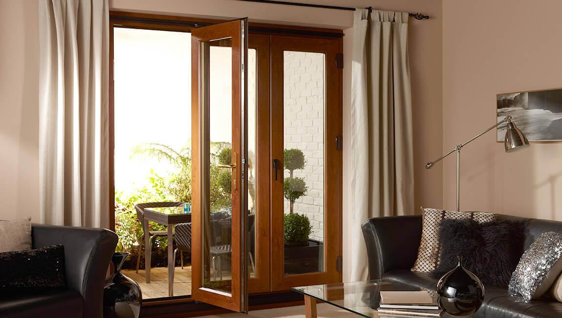 Open golden oak bifold door