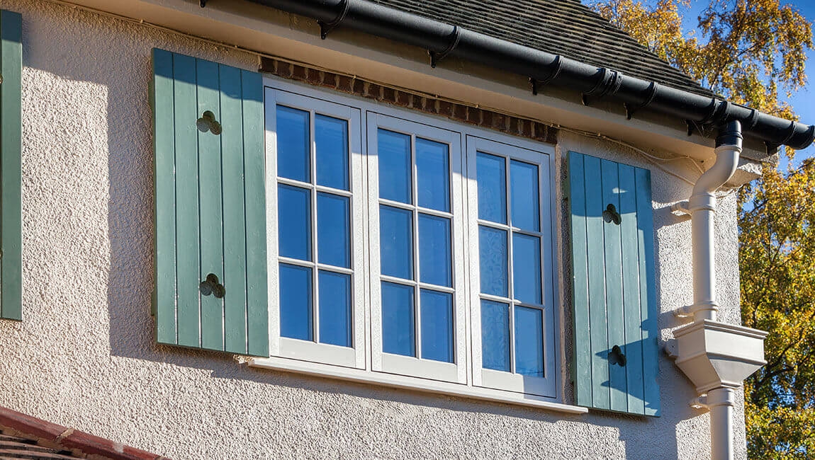 White flush sash window with shutters