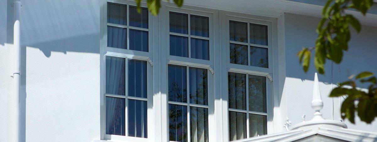 White uPVC vertical sliders