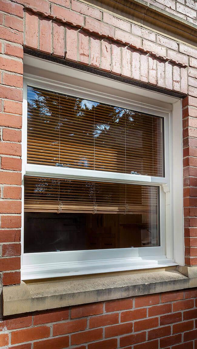 White vertical sliding window